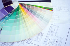Color palette samples lie on house design drawings stock photography