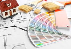 Color palette samples, model of house and brushes. On project drawing royalty free stock images