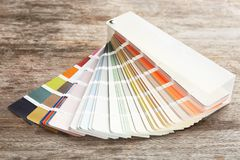 Color palette samples on background. Color palette samples on wooden background royalty free stock image