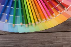 Color palette on the wooden background Royalty Free Stock Photo