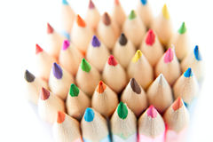 Color palette wooden crayon pencils at white background Royalty Free Stock Photos