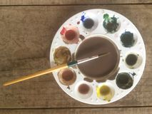 Color palettes and pudding used. Put on wooden board royalty free stock photo