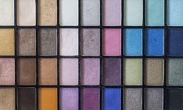Color pallet for make up showing many different colors and color shades. Picture up close with beautiful lights. stock images