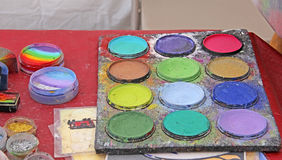Color pallete  of paints and glitter used for face painting Royalty Free Stock Photography