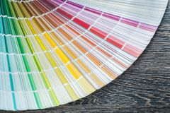 Color pantone fan on wooden board top view Stock Image