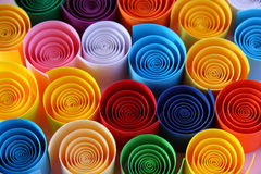 Color paper. Coloured ribbons spinning around. Set of paper strings from an art shop, shaped into a circles in the colours of a rainbow stock photo