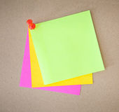 Color paper. And pin on wood texture background Stock Images