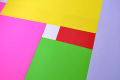 Color paper, abstract composition, the background with yellow, pink, red and green tones Stock Photography