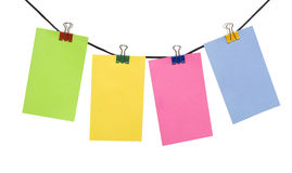 Color paper blank on the rope. Color paper notes on the rope over white Royalty Free Stock Photo