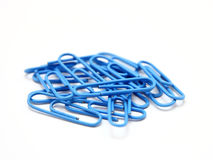 Color paper clips to background. Royalty Free Stock Image