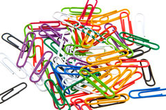 Color paper clips to background. Isolated on white Royalty Free Stock Images