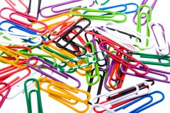 Color paper clips to background. Isolated on white Stock Photo