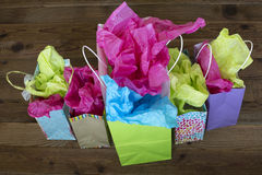 Color paper gift bags and wood background Royalty Free Stock Photo