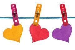 Color paper hearts hung on clothesline Royalty Free Stock Photos