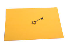 Color paper and key. Retro styled metal key on a sheet of colored paper Stock Photo
