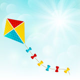 Color paper kite. On sunny background Royalty Free Stock Images