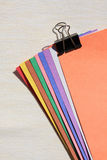 Color paper and paperclip Stock Photos