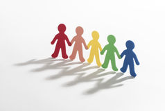 Color paper people. Doing teamwork on white background royalty free stock image