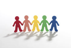 Color paper people doing teamwork Royalty Free Stock Photo