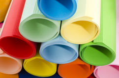 Color paper rolled and piled. Stock Images