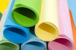Color paper rolled and piled. Royalty Free Stock Image