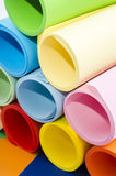 Color paper rolled and piled. Royalty Free Stock Photo