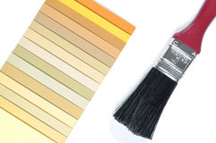 Color paper samples and paint brush Stock Image