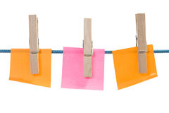 Color paper sheets on rope Stock Photo