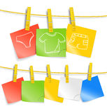 Color paper sheets on rope Stock Images