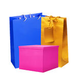 Color paper shopping bags and gift box isolated on white Royalty Free Stock Photography