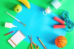 Color paper, sports items and school stationery royalty free stock images