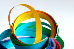Color paper strips in circles. Color paper strips in round shape creating movement. Blue and yellow are the dominant colors royalty free stock photography