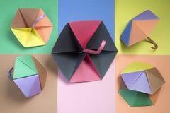 Color paper umbrellas background Stock Images