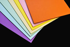 Color paper variety on the black background Royalty Free Stock Photo
