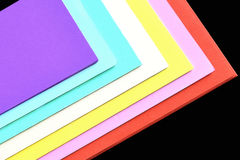Color paper variety on the black background Stock Photo