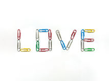 Color paperclips to love on white background Royalty Free Stock Photos