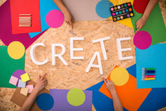 Color papers around create text Royalty Free Stock Photography