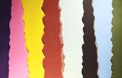 Color papers background. Disorganized ripped  Color papers background Stock Photos