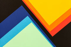 Color papers background. Color papers geometry flat composition background with black blue and orange tones Royalty Free Stock Photography