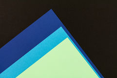 Color papers background. Color papers geometry flat composition background with black and blue tones Royalty Free Stock Photo