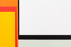 Color papers background. Color papers geometry flat composition background with black orange red and yellow tones Stock Photos