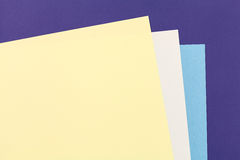 Color papers background. Color papers geometry flat composition background with blue grey and light yellow tones Royalty Free Stock Photos