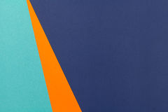 Color papers background. Color papers geometry flat composition background with blue and orange tones Stock Images