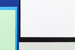 Color papers background. Color papers geometry flat composition background with blue white and black tones Royalty Free Stock Photo