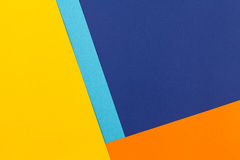 Color papers background. Color papers geometry flat composition background with blue yellow and orange tones Royalty Free Stock Images