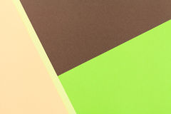 Color papers background. Color papers geometry flat composition background with green and brown tones Stock Image