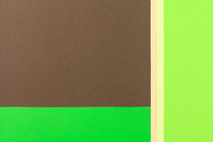 Color papers background. Color papers geometry flat composition background with green and brown tones Royalty Free Stock Images