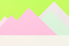 Color papers background. Color papers geometry flat composition background with green and rose tones Stock Images