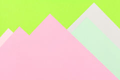 Color papers background. Color papers geometry flat composition background with green and rose tones Stock Photography