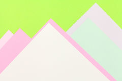 Color papers background. Color papers geometry flat composition background with green and rose tones Royalty Free Stock Photography